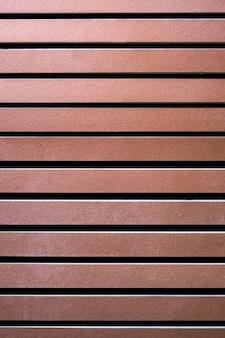 Pannello del condotto di legno marrone o fondo del listello del tetto