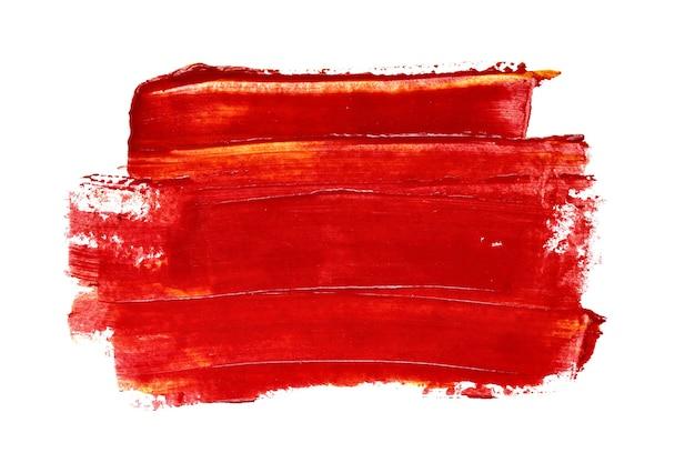 Pennellata di vernice acrilica rossa primo piano isolato su sfondo bianco