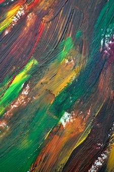 Pennellate macro multicolore di pittura ad olio. sfondo creativo astratto eterogeneo