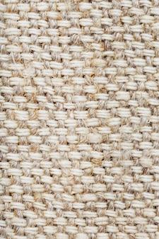 Tessuto di tela con fibre di lino come sfondo. macro a schermo intero