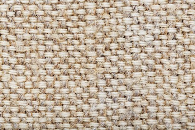 Tessuto di tela con fibre di lino come sfondo.