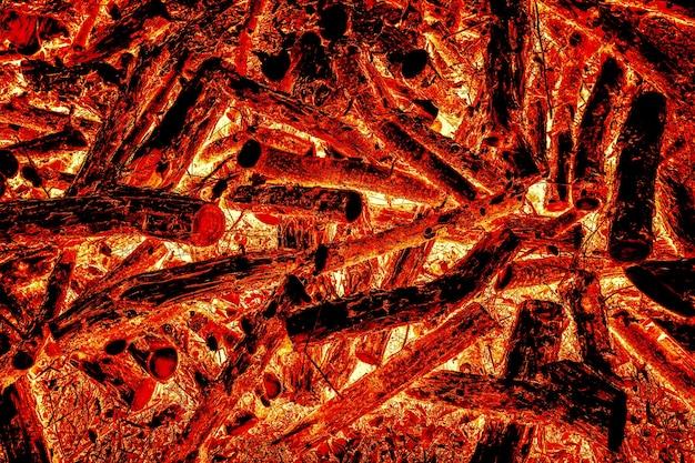 Legna che brucia nel fuoco struttura e modello di materiale naturale fondo rosso del fuoco