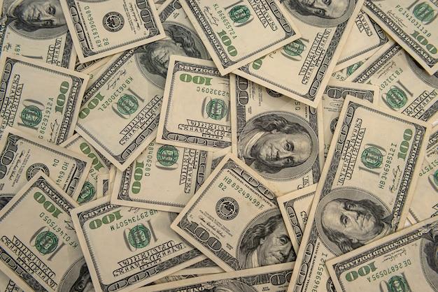 Sfondo aziendale con banconote da un dollaro statunitense, concetto finanziario