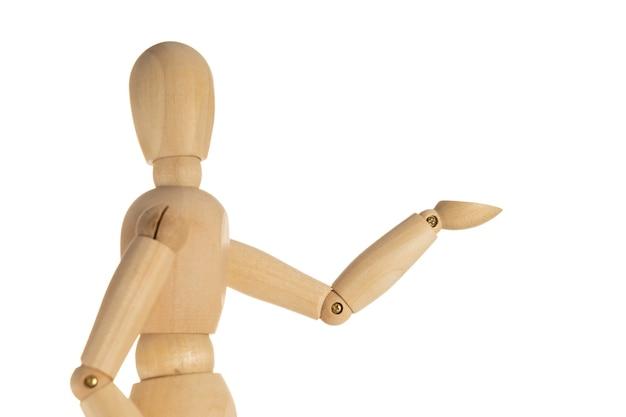 Concetto di business e design - manichino in legno con gesto di benvenuto isolato su sfondo bianco
