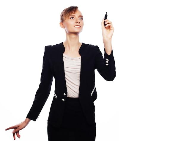 Concetto di affari, finanza e persone: giovane donna d'affari che scrive qualcosa nell'aria con un pennarello