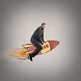 Uomo d'affari su un razzo