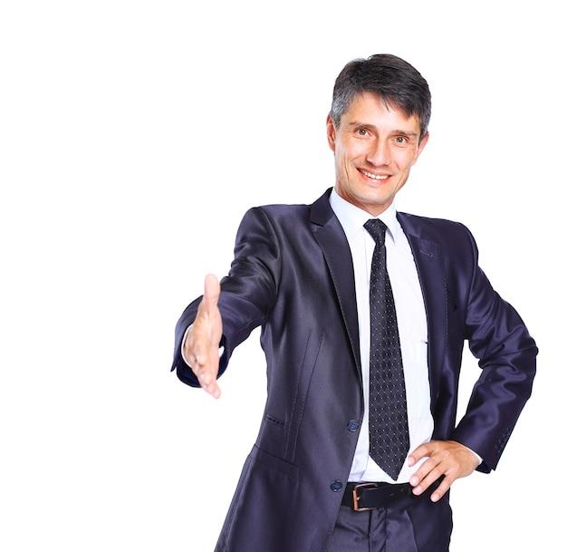 Uomo d'affari con la mano tesa alla stretta di mano - isolato su bianco