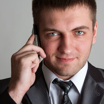 Uomo d'affari con il telefono