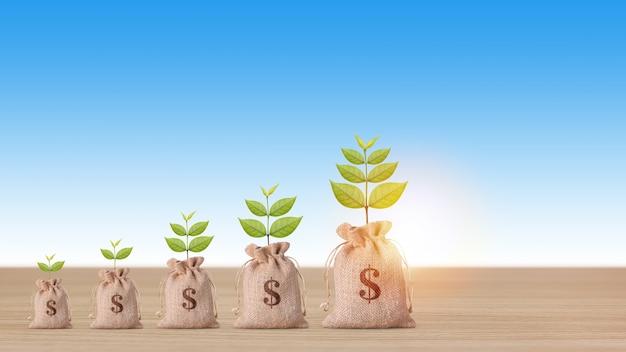 Concetto di investimento immobiliare aziendale, borsa di denaro con crescita di piante e impilamento di monete risparmiando crescita sulla scrivania in legno su sfondo blu studio per il concetto di pubblicità immobiliare finanziaria
