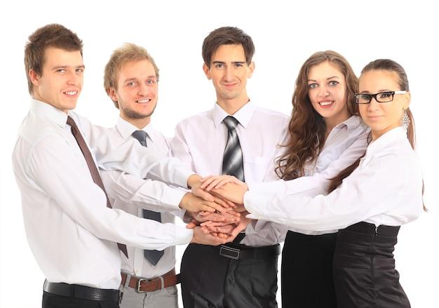 Squadra di affari che mette le mani una sopra l'altra