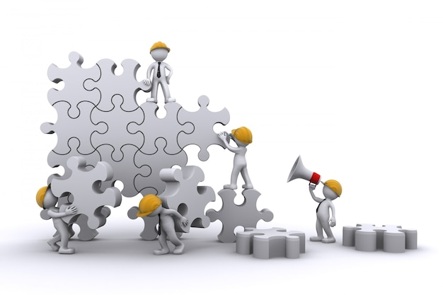 Lavoro di gruppo di affari che sviluppa un puzzle. costruire il concetto di business.