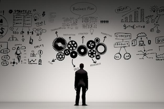 Concetto di visione aziendale con uomo d'affari che scrive business plan