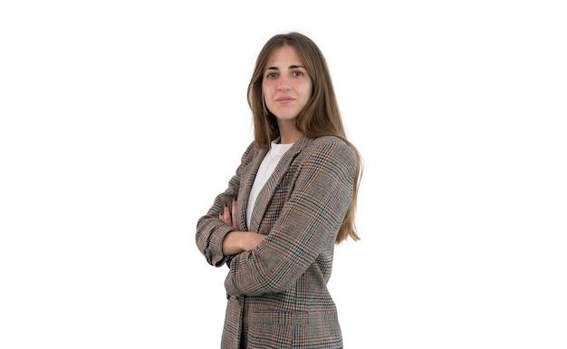Donna di affari in vestito con le braccia incrociate isolate