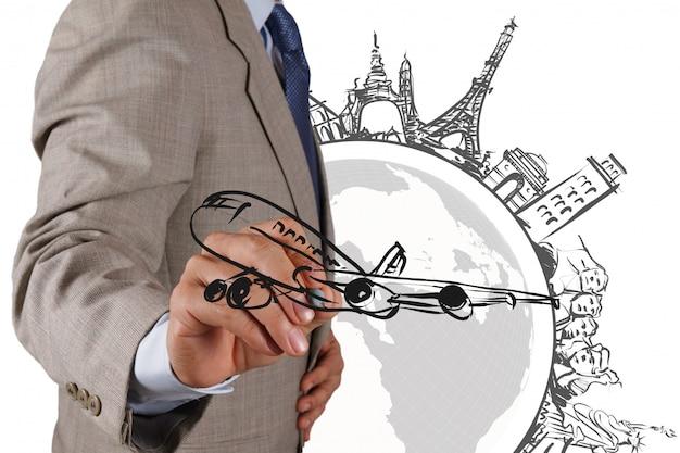 Uomo d'affari disegna viaggi da sogno in tutto il mondo