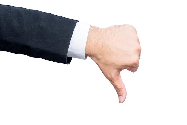 Mani dell'uomo d'affari che mostrano i pollici giù gesto isolato sopra il muro bianco