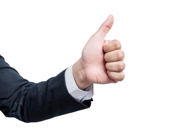 Mani dell'uomo d'affari che mostrano i pollici aumentano il gesto isolato sopra la parete bianca