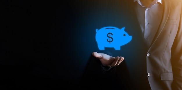 Icona del salvadanaio della tenuta dell'uomo d'affari. pianificazione della spesa aziendale e di denaro e budget di investimento, concetto di risparmio di denaro aziendale.