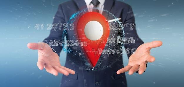 Uomo d'affari che tiene un supporto del perno della rappresentazione 3d su un globo con le coordinate