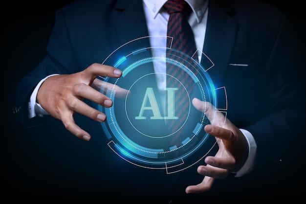 Uomo d'affari che tiene sulla dicitura ai (artificial intelligence) con lo sfondo di progettazione del circuito di tecnologia hi-tech digitale cerchio. innovazione di concetto.