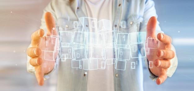 Uomo d'affari che tiene una nuvola del cubo di blockchain e della rappresentazione di dati 3d del file binario