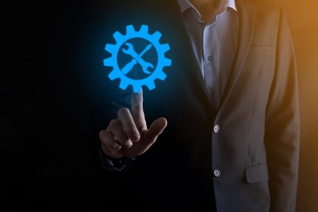 Uomo affari, presa a terra, ingranaggio, icona, con, tools., ingranaggio, concetto, di, obiettivo, fuoco, digitale, diagramma, grafico, interfacce, virtuale, interfaccia utente, schermo, connessioni, netwoork.