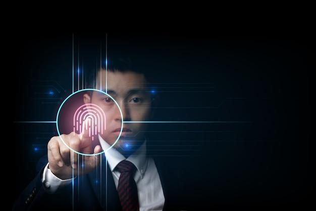 Identità biometrica e approvazione dell'impronta digitale della scansione dell'uomo d'affari. concetto di sicurezza della tecnologia aziendale.