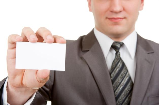 Uomo d'affari che mostra scheda in bianco