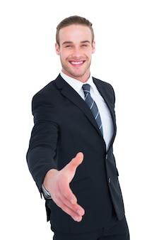Uomo d'affari sorridendo e offrendo la sua mano