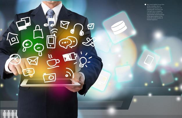 Uomo d'affari e tablet pc sullo sfondo