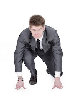 Uomo d'affari che prende un inizio basso per correre
