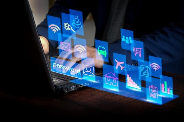 Uomo d'affari che utilizza laptop per comunicare online tramite wifi concetto di comunicazione senza limiti
