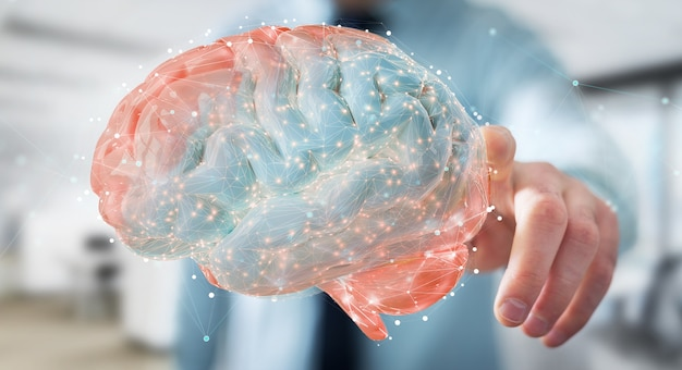 Uomo d'affari utilizzando utilizzando la proiezione 3d digitale di un cervello umano