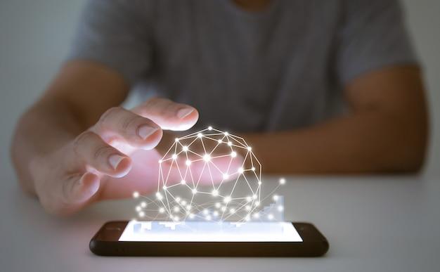 Gli uomini d'affari analizzano i grafici con il mondo dei social network con smartphone e tablet