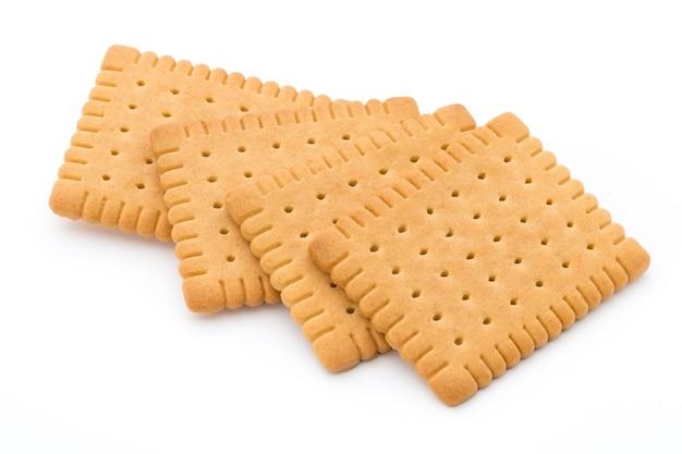 Cracker di burro su priorità bassa bianca.