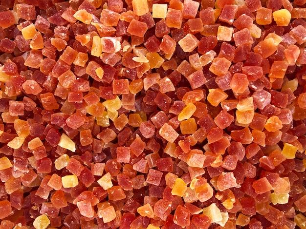 Dessert della miscela del cubo di frutti canditi come struttura del fondo