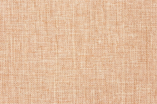 Panno di tela, tela da imballaggio, arredamento rustico. iuta naturale iuta, tessitura. sfondo astratto tessuto marrone chiaro.