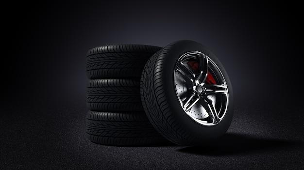 Cerchio per auto e pneumatico in piedi sulla strada asfaltata