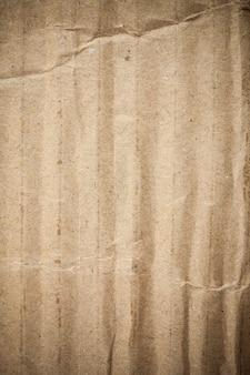 Scenetta del fondo della carta marrone del cartone. Foto Premium