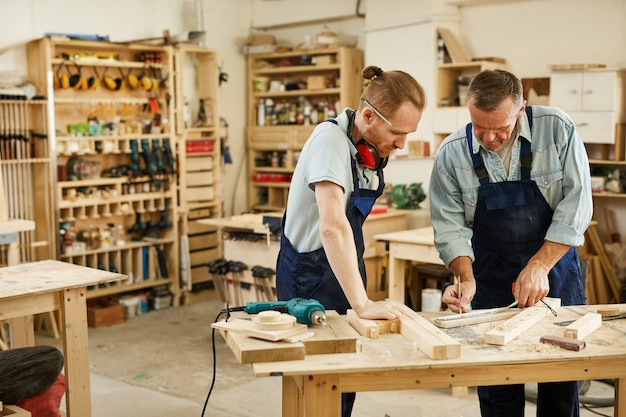 Carpenter teaching apprentice