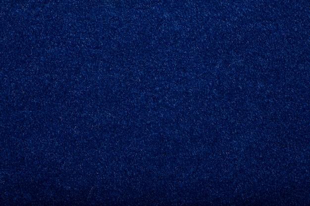 Tappeto che copre lo sfondo. modello e trama del tappeto di colore blu. copia spazio