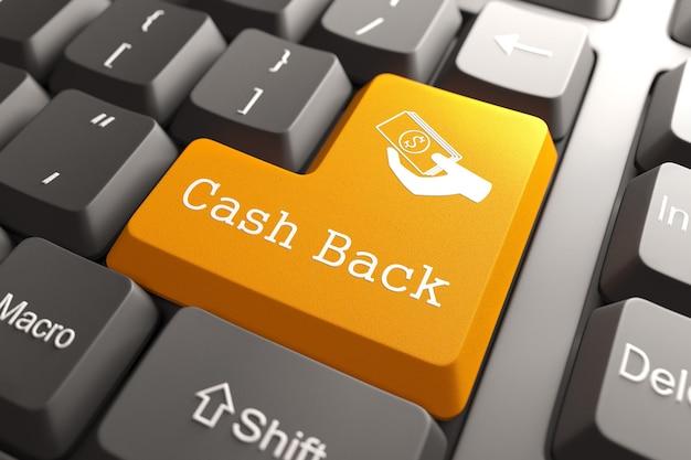 Icona di cash back pulsante arancione sulla tastiera del computer