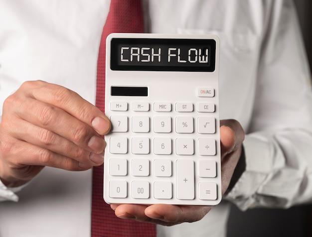 Parola di flusso di cassa sulla calcolatrice, iscrizione di flusso di cassa.