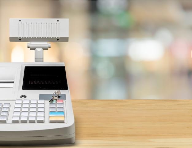 Registratore di cassa con display lcd sullo sfondo