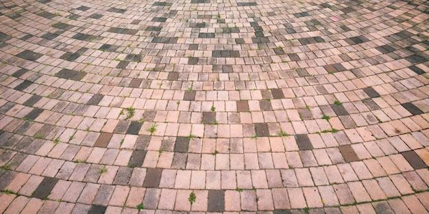 Pavimento in mattoni di cemento con sfondo a curva circolare