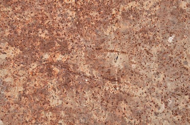 Cemento su metallo arrugginito per lo sfondo