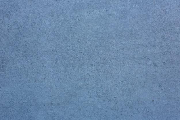 Piastrella in ceramica blu con motivo di superficie in pietra astratta ruvida