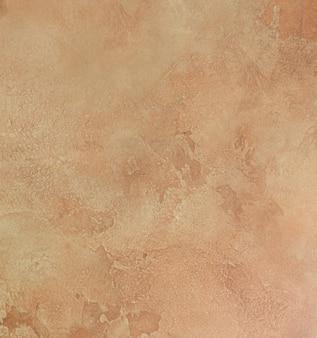 Piastrella in ceramica marrone con motivo di superficie in pietra astratta ruvida