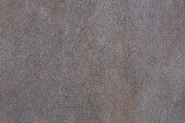 Piastrella in ceramica grigia con motivo di superficie in pietra astratta ruvida