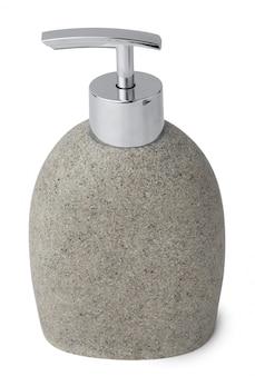 Dispenser di sapone in ceramica simile alla pietra isolato su bianco