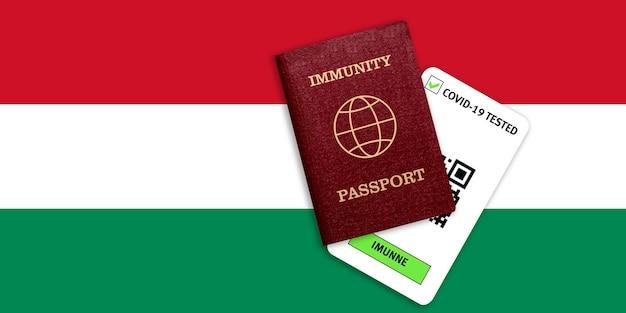 Certificato per viaggiare dopo una pandemia per le persone che hanno avuto il coronavirus o fatto il vaccino e il risultato del test per covid-19 sulla bandiera dell'ungheria